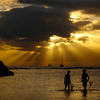 02 Jan 2007, Honolulu, Oahu, Hawaii, USA --- Two boys with fishing nets stand along the shoreline at sunset near Magic Island, at Ala Moana Beach in Honolulu, Hawaii, January 1, 2007.  REUTERS/Lucy Pemoni (UNITED STATES) --- Image by © LUCY PEMONI/X01574/Reuters/Corbis