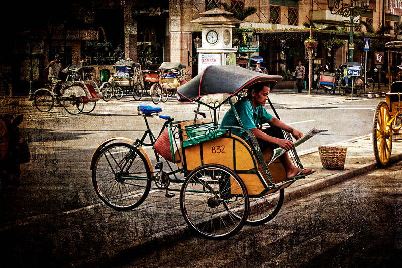 Becak Driver Reading Paper in Yorgjakarta