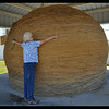 IM hugging the world's biggest ball of twine.