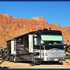 Phay, JW and the Red Cliffs in Moab at our RV Site for the Night