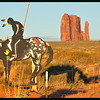 Indian on Spotted Horse art with West Mitten Butte in Background at Sundown