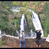 People photographing the waterfall from the overlook near the parking area.