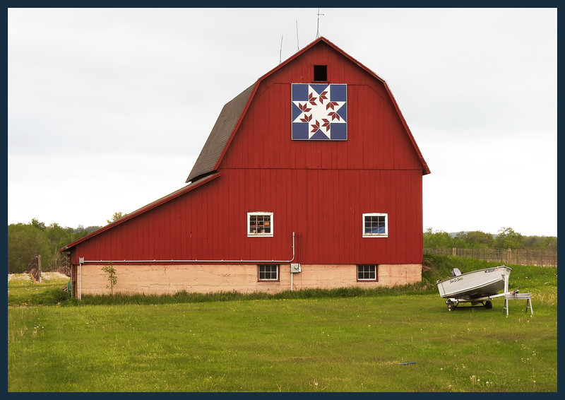 Red barn and a boat.