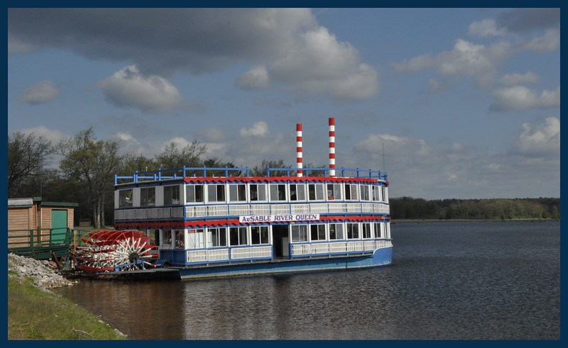 "The Au Sable River, the ""AuSable River Queen"" paddle wheel boat."