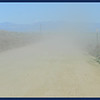 Saddle Rock Road - Wind caused dust, no vehicle ahead of us.  Strong winds are a sign of Spring in New Mexico.