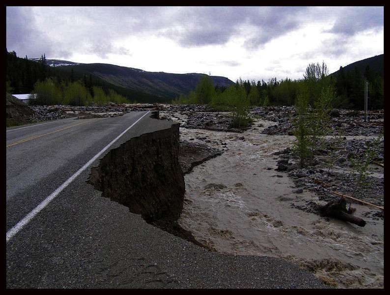 300 to 400 feet of the Alaskan Highway was gone and the water was still flooding the area.  More rain was predicted for early the next week.  (Photo sent to me by Sgt. Lockwood, RCMP)