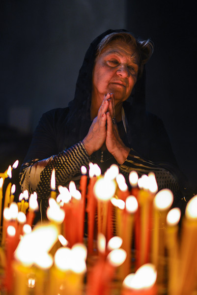 A lady prays during Easter mass at Etchmiadzin Cathedral, the seat of the Armenian Orthodox Church.