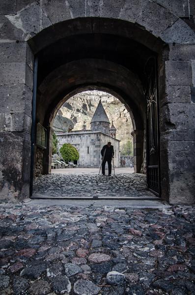 A man visits Geghard Monastery