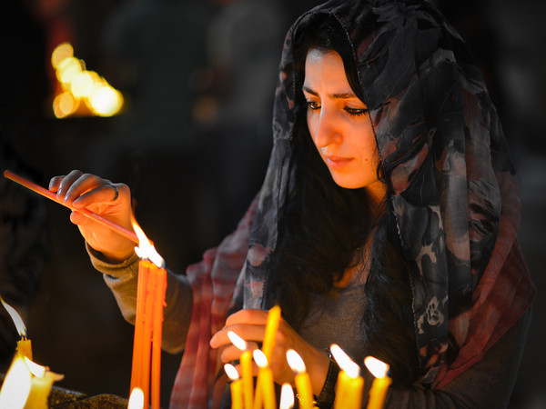 A girl lights a candle at Echmiazin cathedral during Easter Sunday.