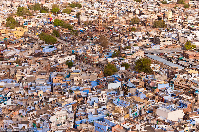 "Jodhpur view from Mehrangarh Fort. In the back Sadar market sqare can be seen with it's prominent clock tower.<br /> Jodhpur is also named as ""the blue city"" because of the  many blue buildings in the old town. Today anybody can have a blue house. In ancient times it was the privilege of the Brahman caste. The indigo pigment not only coloured the paint but was also effective against insects."