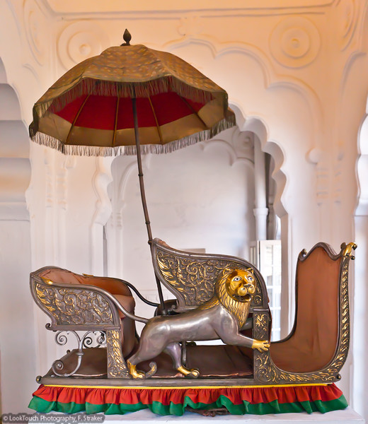 Elephant howdah from late 19. century<br /> This device was strapped around an elephants stomach. Wooden frame incased with embossed polished silver sheets.