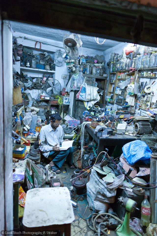 Patron in his workshop for motor repair