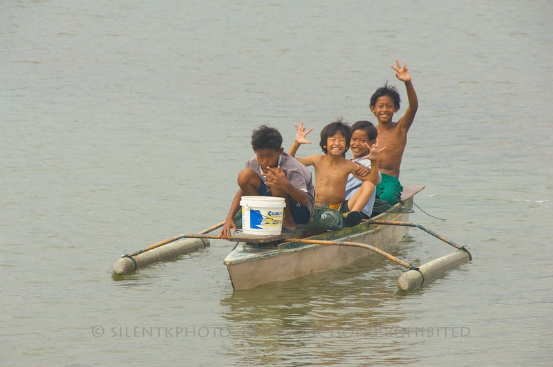 Young kids out on the boat from the river village at Kota Kinabalu.