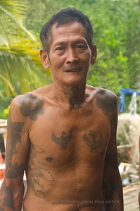 From the Iban village - a tribal elder with tattoos.