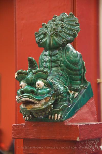 Kuala Lumpur, Malaysia - Guard dogs at Chinese temple.