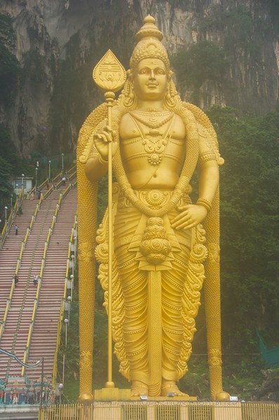 The Hindu statute at the Batu Caves in Kuala Lumpur with the 272 steps to the limestone caves in the background.
