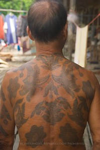 Chief of the Iban village, with elaborate tattoos on his back.