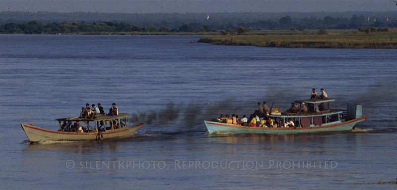 Getting a tow - Ayeyarwady River - Burma.