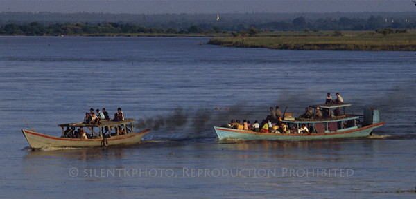 Getting a tow - Ayeyarwady River - Burma.