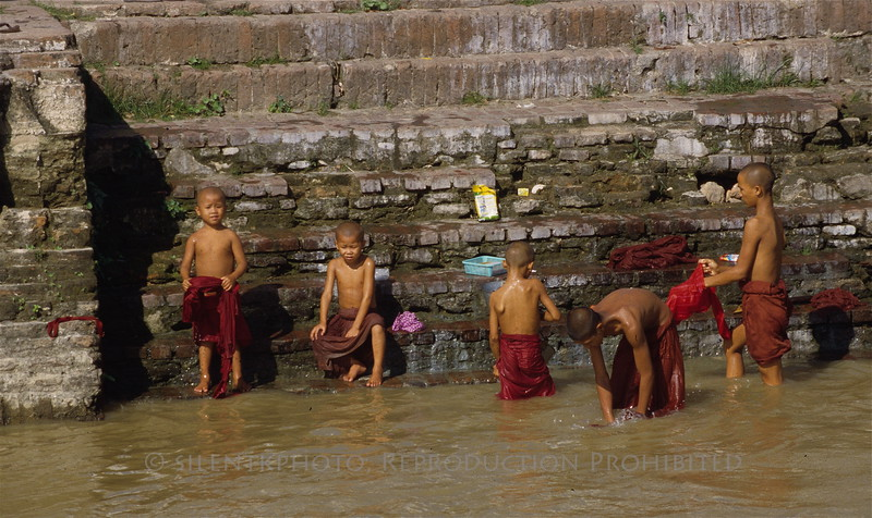 Monks and boys - bathing in the Ayeyarwady - Burma.