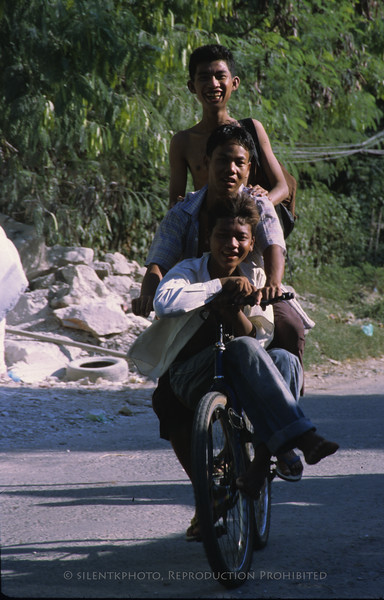 Three boys on a bike - Burma.