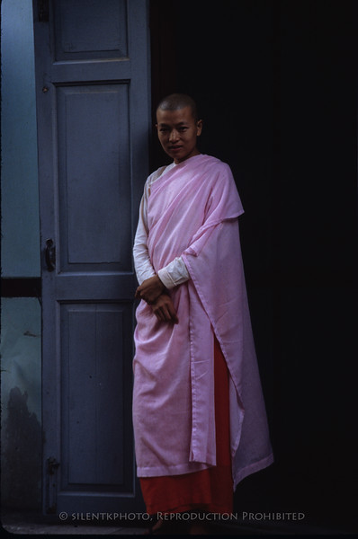 A nun posed in the doorway of a missionary building which we visited.