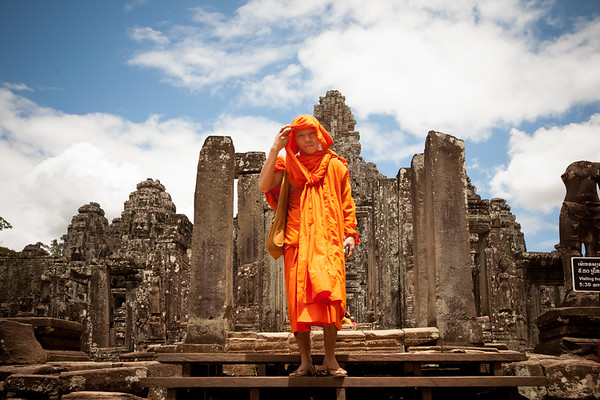 A monk just outside the Bayon Temple at Angkor in Cambodia. www.rusticpathways.com Credit: Rustic Pathways Copyright: © 2015 Rustic Pathways Usage with express permission only.