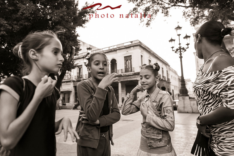 Aspiring ballerinas, at the Prado Boulevard, visiting each other while waiting for ballet classes   at the Ballet Nacional de Cuba in Habana.