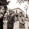 Aspiring ballerinas, at the Prado Boulevard, visiting each other while waiting for ballet classes   at the Ballet Nacional de Cuba in Habana.