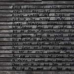 A close-up of the writing on the wall.