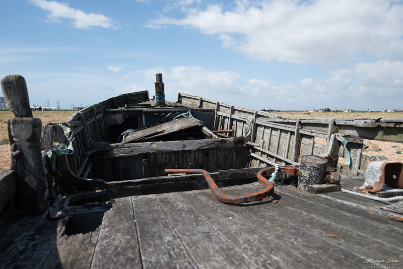 They sure looks very post-apocalyptic, and it kinda matches Dungeness too. There's very few people around, and if you exclude the tourists or the photographers, I think you will be able ask everyone else their name, and be able to remember their name at the end of the day.