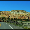 "Windshield shot (by IM while I was driving), of the yellow sandstone ""caprock"" formations"