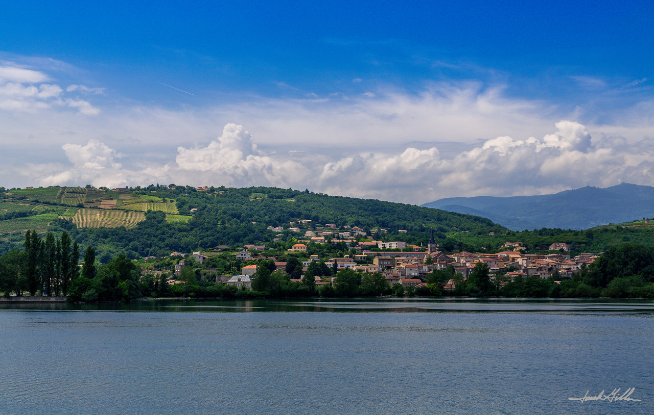 View of the Rhone River and village