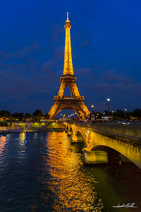 Eiffel Tower lights reflection on Seine River