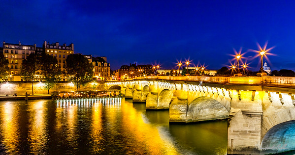 Reflecting and glistening lights of the Pont Neuf Bridge