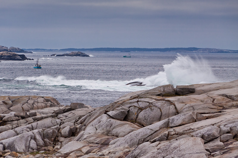 Crashing waves and high surf on the rocky atlantic coastline of Nova Scotia, Canada, at the famous fishing village of Peggy's Cove.