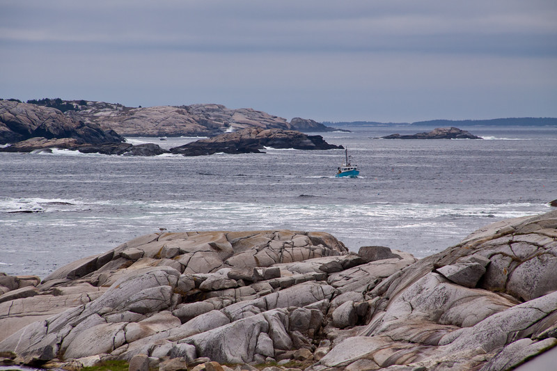 Fishing boat on a cold, rainy day at Peggy's Cove near Halifax, Nova Scotia, Canada.