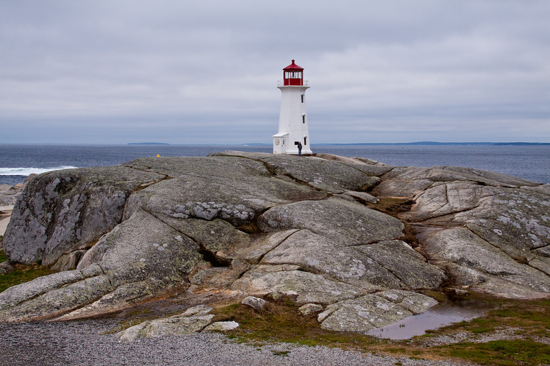 Peggy's Point Lighthouse on a stormy day in May at Peggy's Cove near Halifax, Nova Scotia, Canada, was first erected in 1868. Peggy's Cove is one of the most popular tourist spots in Nova Scotia and the lighthouse may be the most photographed in the world.