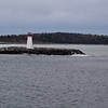 Maughers Beach Lighthouse, established  1815, stands at the end of a curving white sand beach on the west side of McNabs Island, at the inner entrance to Halifax harbour in Halifax, Nova Scotia, Canada.