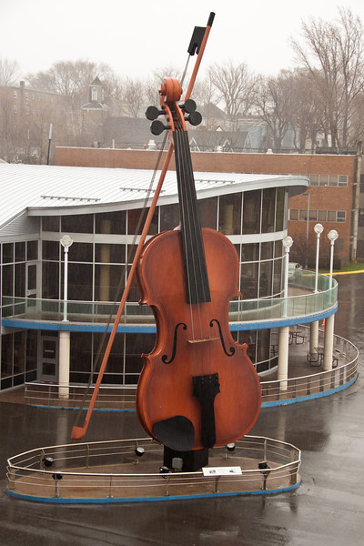 Cold, rainy day at cruise ship dock at Sidney, Nova Scotia, Canada. World's largest fiddle sculpture on dock represents the scottish folk music for which Sidney is known.
