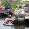 Peggy's Cove fishing village (and tourist attraction) on a cold, rainy day in May, at Nova Scotia, Canada.