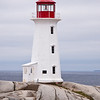 Peggy's Point Lighthouse on a stormy day in May at Peggy's Cove near Halifax, Nova Scotia, Canada, was first erected in 1868. Peggy's Cove is one of the most popular tourist spots in Nova Scotia and the lighthouse may be the most photographed in the world. It is often called (incorrectly) Peggy's Cove Lighthouse.