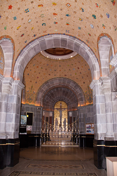 Sainte-Anne de Beaupré Basilica on the shores of the St. Lawrence River, 20 miles above Quebec City in Canada. The Basilica of Sainte-Anne-de-Beaupré is a major Catholic shrine and place of healing that attracts more than a million pilgrims per year. The church is dedicated to St. Anne, mother of Mary and grandmother of Jesus, and it is an incredibly beautiful work of art in its interior design and sculpture.