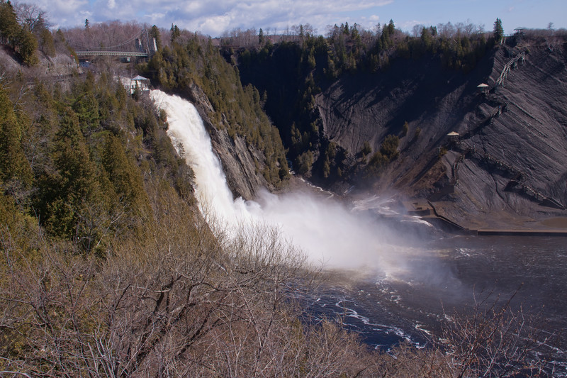 Montmorency Falls - at 270 feet, 90 feet higher than Niagara Falls - empties into the St. Lawrence River a few miles above Quebec City, Quebec, Canada. The Montmorency Falls, on the Montmorency River, are located in front of the Island of Orleans (in the St. Lawrence River) and were named by Samuel de Champlain for his patron, the duke of Montmorency. Though higher than Niagara, they are far narrower.