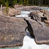 Natural Bridge Formation on the Kicking Horse River in Yoho National Park in British Columbia, Canada. Natural Bridge is an impressive natural rock formation that spans the flow of the Kicking Horse River west of Field, where the slower-moving waters from the Field valley flats begin their descent through a canyon to be joined by the Amiskwi River.