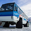 Snow Coach tour bus at the Athabasca Glacier. The Athabasca is the most-visited glacier on the North American continent. Situated across from the Icefield Centre, its ice is in continuous motion, creeping forward at the rate of several centimeters per day. Spilling from the Columbia Icefield over three giant bedrock steps, the glacier flows down the valley like a frozen, slow-moving river. Because of a warming climate, the Athabasca Glacier has been receding or melting for the last 125 years. The Columbia Icefield is a surviving remnant of the thick ice mass that once mantled most of Western Canada's mountains. Lying on a wide, elevated plateau, it is the largest icefield in the Canadian Rockies. Nearly three-quarters of the park's highest peaks are located close to the icefield.