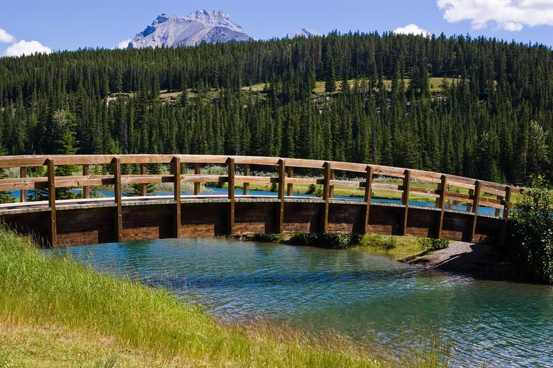 Bridge over Cascade Pond along Loop Minnewanka road, near the town of Banff, in Banff National Park, Alberta, Canada.