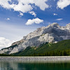 Lake Minnewanka surrounded by the mountains of the Canadian Rockies, in Banff National Park, Alberta, Canada.