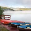 Canoes in fog on Patricia Lake in Jasper National Park, Alberta, Canada.