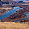 Red Deer River in the Canadian Badlands in southern Alberta, Canada. Millions of years of compressed sea deposits have been carved by glaciation and subsequent erosion into a striking landscape of strangely-sculpted badland formations and rolling prairies bisected by coulees and deep river valleys.